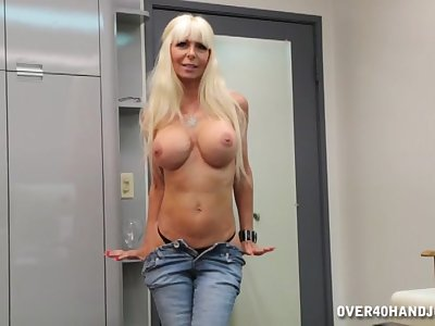 Blonde of age Kasey Storm with fake chest makes him cum fast
