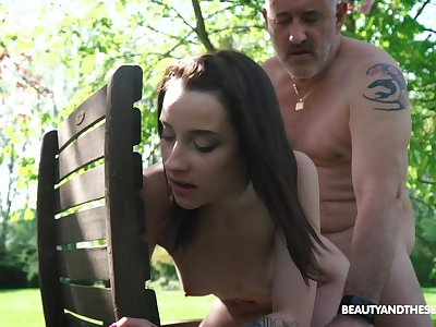 Nympho Charlotte Johnson is spying on naked old neighbor in the garden